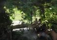 Taras z kaskadą i hustawką nad stawem